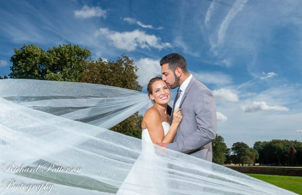 Essex Wedding Photographer, Essex Wedding Photography, Bride and Groom cathedral veil photograph